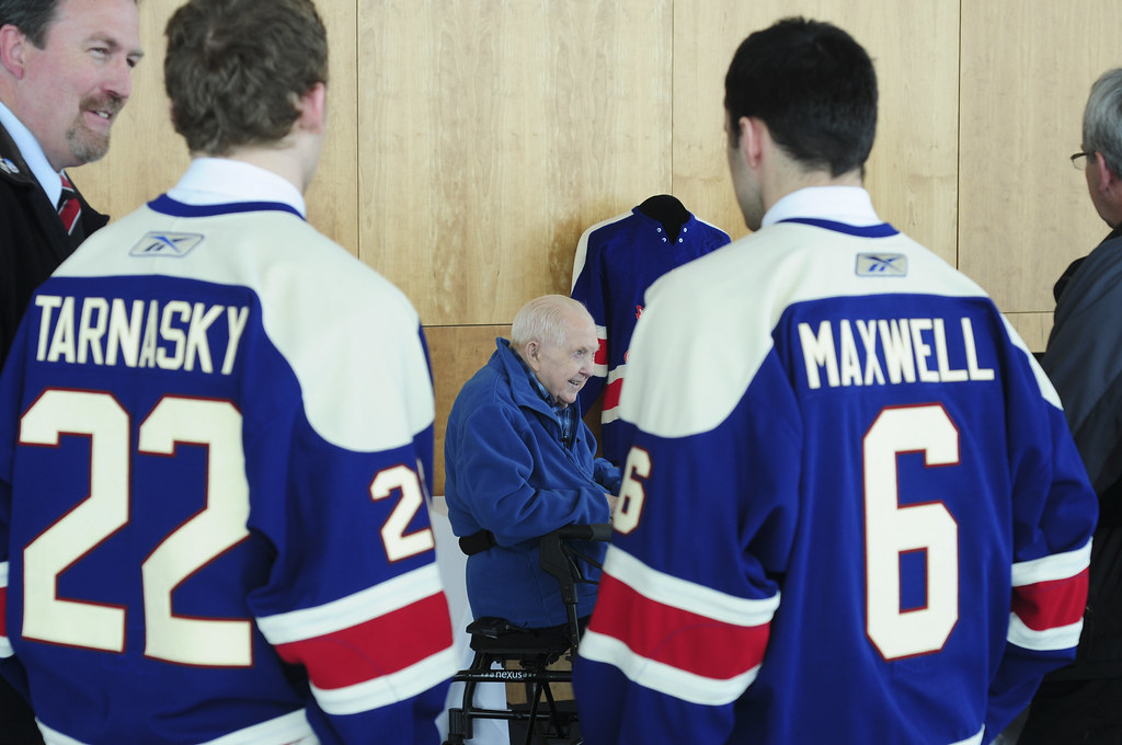 Neil Tarnasky and Mitch Maxwell look on while Nap Milroy speaks with the media