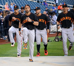Angel Pagan and the Giants stretch before the NL Wild Card Game.