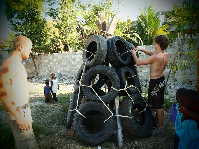 Building the tire teepee the kids can play inside or for Tire play structure
