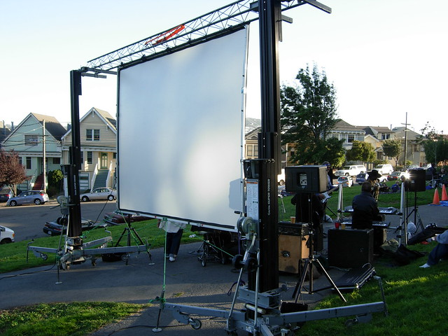 outdoor rear projection screen Projection screen styles including: portable screens, pull-down screens, motorized screens, rear projection, and permanent wall projector screens by da-lite and draper.