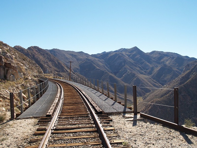 We cross a wooden trestle. You can see the huge Goat Canyon Trestle in the distance just right of center.