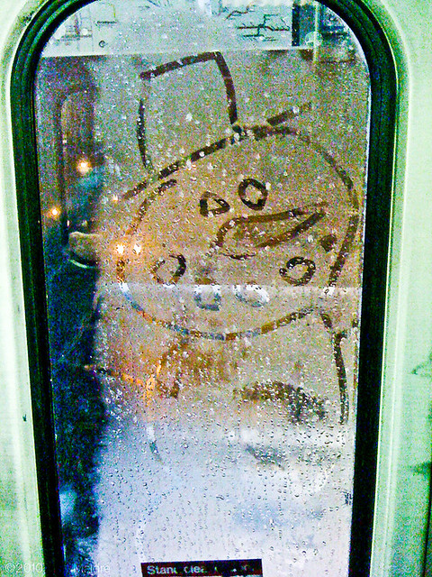 Snowman drawing on window
