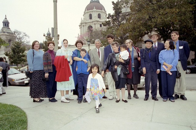 Me with the red coat and headscarf at my cousin Daniel's baptism in Los Angeles.