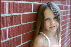 Girl portrait against brick