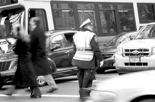 Traffic cop in NYC keepin' it movin'..