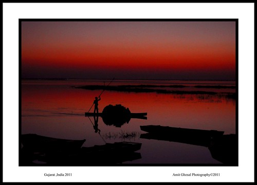 sunset india lake boat colours amit ghosal nalsarover