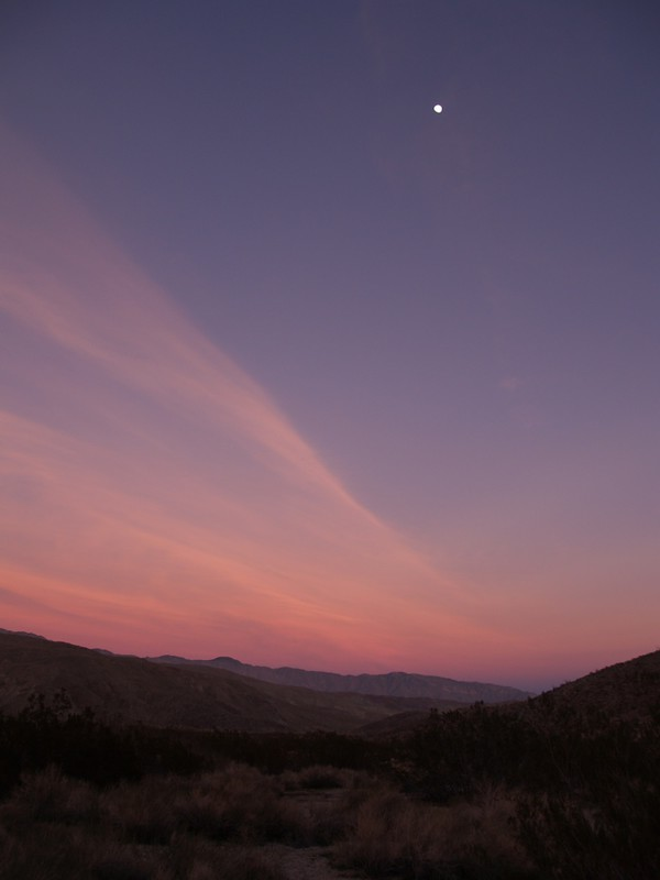 The moon over Collins Valley at sunset