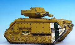 construction equipment(0.0), churchill tank(0.0), m113 armored personnel carrier(0.0), bulldozer(0.0), armored car(1.0), combat vehicle(1.0), military vehicle(1.0), weapon(1.0), vehicle(1.0), tank(1.0), self-propelled artillery(1.0), scale model(1.0), military(1.0),