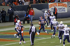 Tebow in the act of making a touchdown