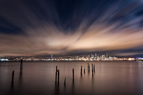 seattle city sea water skyline night clouds washington alki pugetsound elliottbay piling streaking exploding
