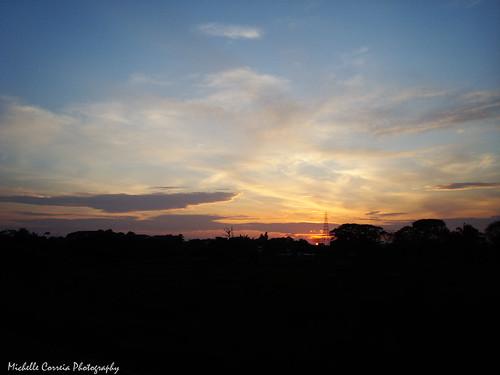 blue sky orange clouds sunrise