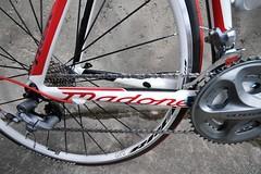 bmx bike(0.0), freestyle bmx(0.0), tire(1.0), road bicycle(1.0), wheel(1.0), vehicle(1.0), sports equipment(1.0), rim(1.0), racing bicycle(1.0), bicycle wheel(1.0), bicycle frame(1.0), bicycle(1.0), spoke(1.0), tarmac(1.0),