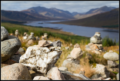 Offering cairns at Loch Loyne. Travellers build these small cairns at a vantage point overlooking the loch in appreciation of the breathtaking views. Photo by Tim Haynes