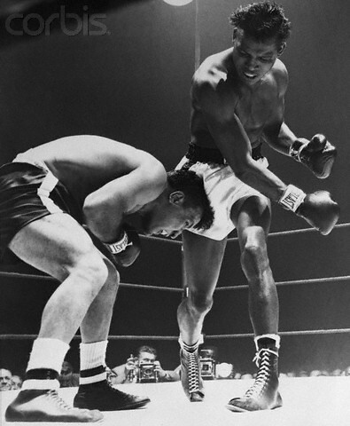 The hammering fists of Sugar Ray Robinson beat down the head of desperately weaving Jake LaMotta, Chicago 1951