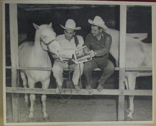 Bob Wills, Tommy Duncan, and a horse read a newspaper