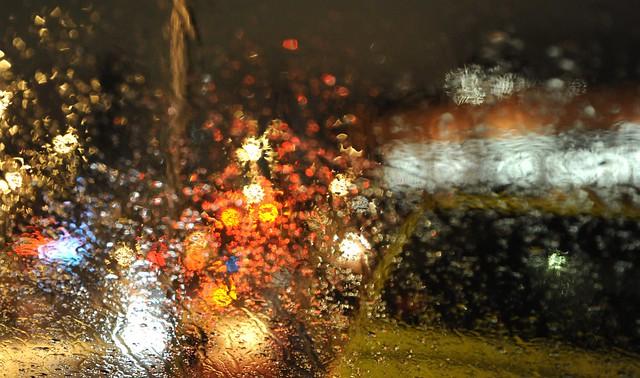Abstract rain shot of street lights near Starbucks, cab, Seattle, Washington, USA