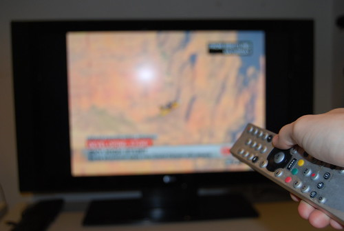 TV, Television and remote controller - stock photo