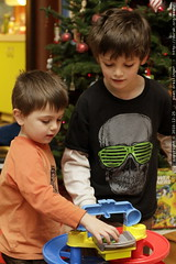 """brothers playing with a """"toy story 3"""" themed car tra…"""
