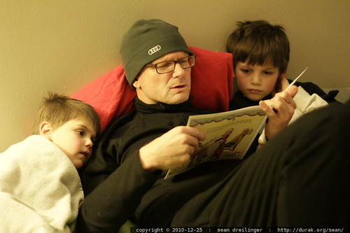 grandpa jeff reading a bedtime story to his grandsons