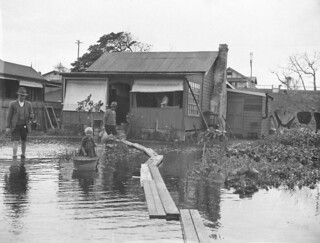 Narrabeen flooding; duck-boards for access, April 1927, by Sam Hood