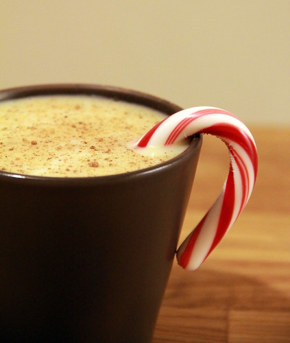 Egg Nog with a sprinkle of nutmeg & a candy cane