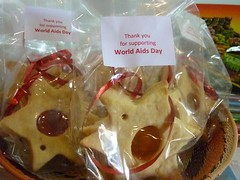 World Aids Day 2010 - Cake Sale :: The Backpack Cape Town posted a photo: 	   Thando at the cake table  World Aids Day 2010 - Cake Sale  This year we decided to have a cake sale and donate the proceeds to the Baphumelele Childrens home in Khayelitsha.  All the staff members baked something and Thando sold the cake to guests and businesses in the area.
