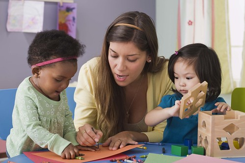 Preschool teacher with toddlers