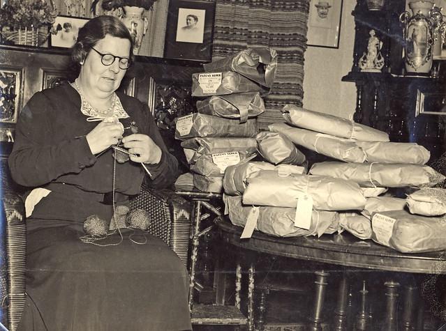 "Miss Ruby Grisdale, Hamilton Red Cross, knitting socks in her home ""Drungalee"", Beamont Street Hamilton, NSW, Australia, 1939"