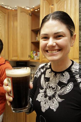 enjoying guiness, a refreshing low carb, gluten free beverage