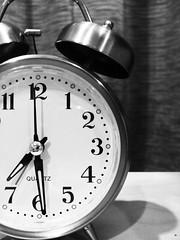 decor(0.0), watch(0.0), alarm clock(1.0), monochrome photography(1.0), clock(1.0), monochrome(1.0), black-and-white(1.0),