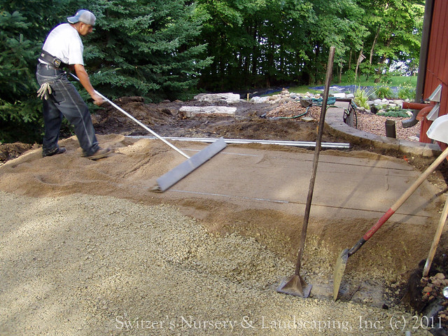 Privacy pergola and paver walk during installation of for Installing patio pavers on sand