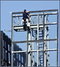 Window Cleaner on Superstructure of an Apartment Block. by fotograf1v2