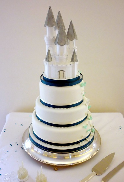 Teal and diamante castle wedding cake Well I've finally lost my'stacked