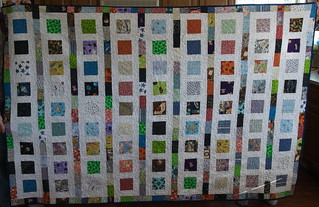 Stargirl is ready to go home with Crystal. It's my first quilt made, start to finish, after Jeff's accident.  For the details on this quilt, why it matters, and why it has the fabrics it does: domesticat.net/quilts/stargirl