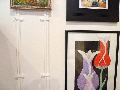 The easy way to hang artwork on paneling without nails Hang up paintings without nails