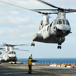 Helicopters lift off from USS Essex to support relief operations in Japan.