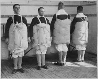 Recruits with their mattresses tied to them to serve as life preservers.