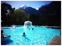 Time to relax! Views of the Alps from the outdoor pools at Lavey-les-Bains day spa in the Rhone valley near Lake Geneva.