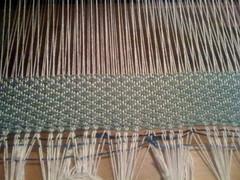 window treatment(0.0), loom(0.0), bamboo(0.0), curtain(0.0), window covering(0.0), interior design(0.0), net(0.0), art(1.0), weaving(1.0), textile(1.0),