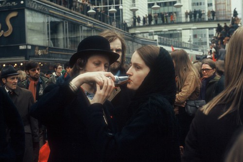 Sharing a drink, demonstration Stockholm 1970s