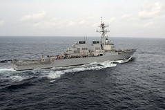 In this file photo, USS Mustin (DDG 89), aligns course with the USNS Tippecanoe (T-AO 199) to conduct an underway replenishment while underway in the Pacific Ocean Feb. 17, 2011. (U.S. Navy photo by Mass Communication Specialist 3rd Class Brian A. Stone)