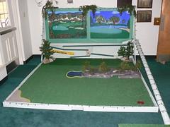 sport venue(0.0), play(0.0), sports(0.0), recreation(0.0), billiard table(0.0), grass(1.0), recreation room(1.0), games(1.0), miniature golf(1.0), flooring(1.0),