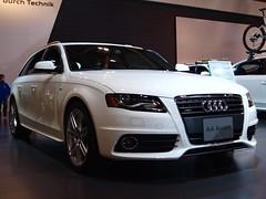 sedan(0.0), automobile(1.0), automotive exterior(1.0), audi(1.0), executive car(1.0), family car(1.0), wheel(1.0), vehicle(1.0), automotive design(1.0), rim(1.0), auto show(1.0), grille(1.0), audi a4(1.0), bumper(1.0), land vehicle(1.0), luxury vehicle(1.0),
