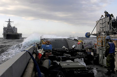 PACIFIC OCEAN (April 2, 2011) — Sailors embarked aboard amphibious transport dock ship USS Tortuga (LSD 46), pilot a landing craft toward the well-deck after the ship transferred heavy equipment to USS Essex (LHD 2). Tortuga is operating in the U.S. 7th Fleet area of responsibility supporting Operation Tomodachi as directed. (U.S. Navy photo by Mass Communication Specialist 1st Class Josh Huebner)