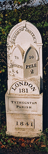 on road in Wales, route marker to London