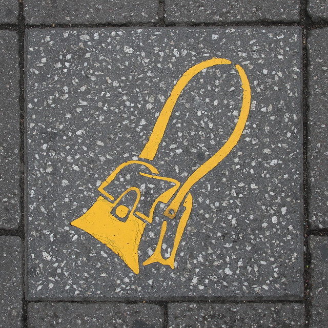 paving slab motif - yellow handbag