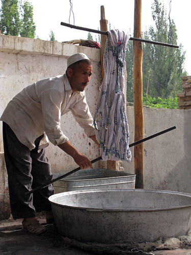 Twisting silk to remove excess water - Hotan | by retrotraveller