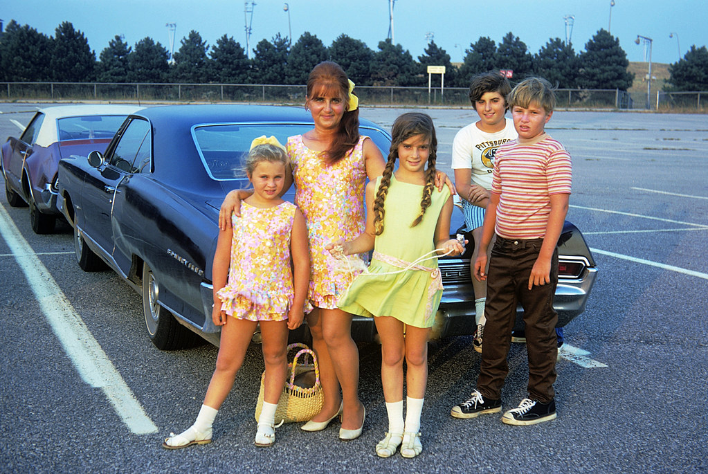 Picking up our Los Angeles cousins at JFK airport in New York so they could spend the summer with us in Milford Connecticut by the beach. I'm on the trunk and sis is in the green dress.  July 1972