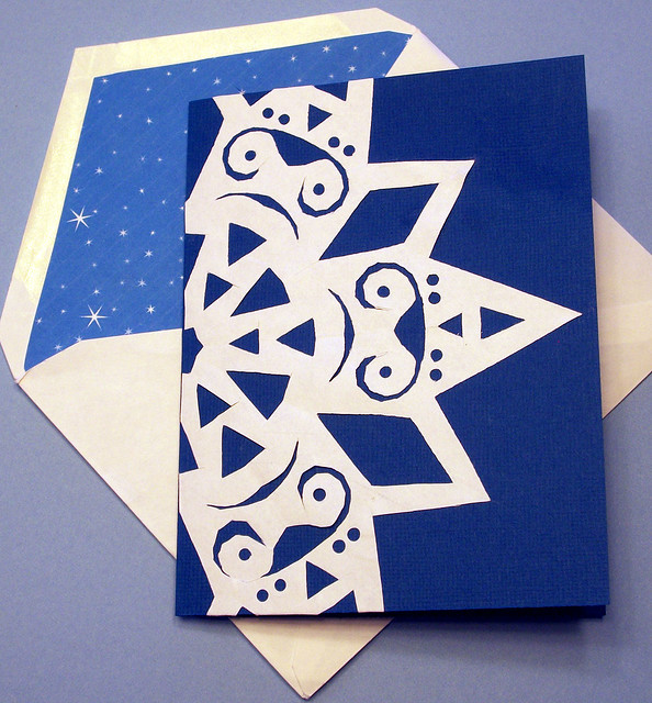 Decorate card with paper snowflake