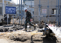 HACHINOHE, Japan (March 28, 2011) Chief Builder Billy Knox of Chapin, Ill., assigned to Naval Facilities Engineering Command Far East, surveys Fuel Pumping Station 2 as dewatering efforts continue at the site. (U.S. Navy photo by Mass Communication Specialist 2nd Class Devon Dow)